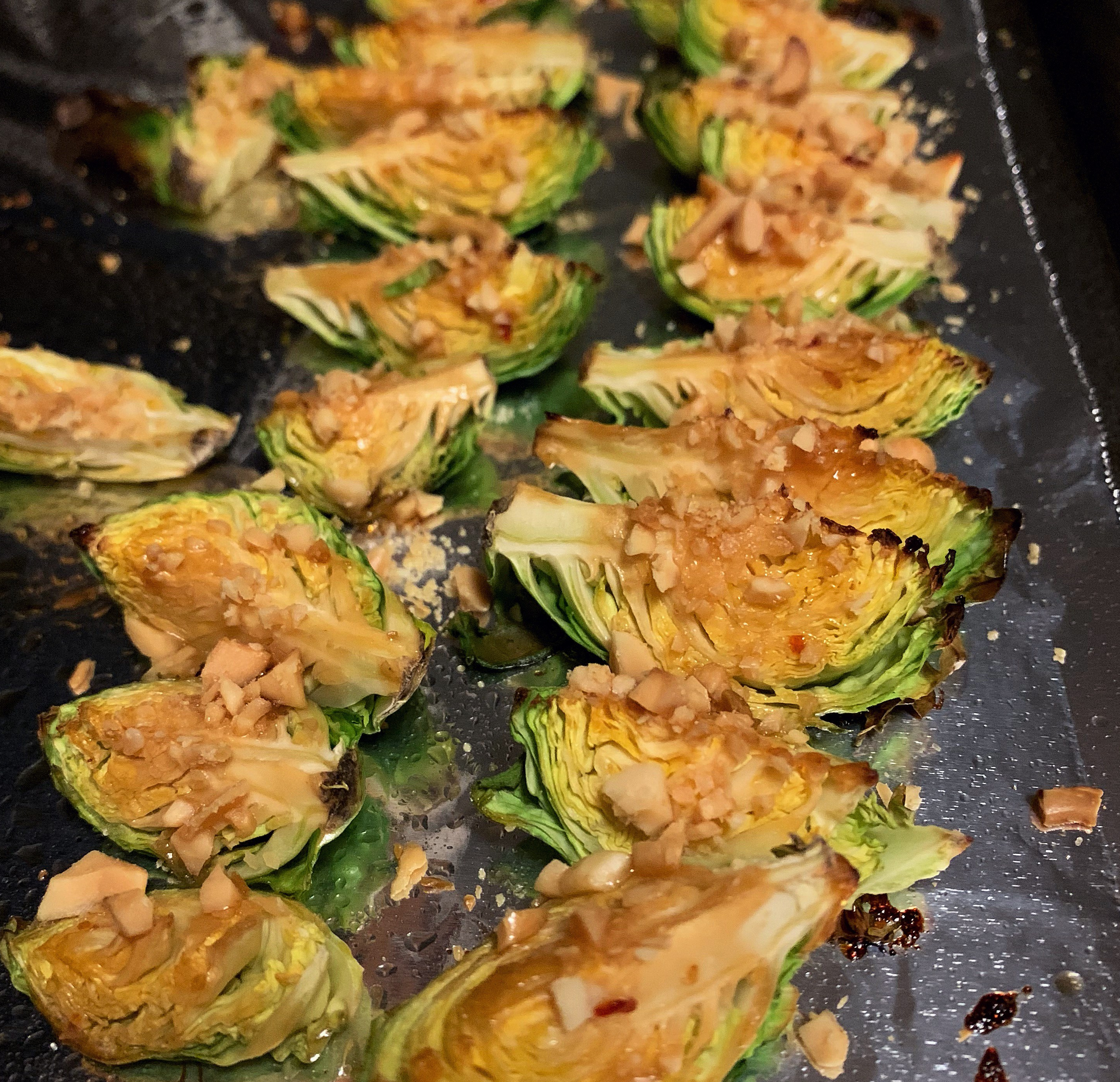 Roasted Brussels sprouts with crushed nuts and General Tso's sauce