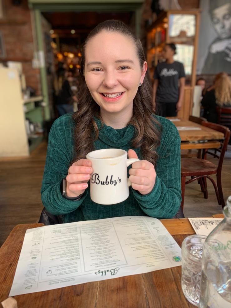 Lindsey Welch holding a coffee mug