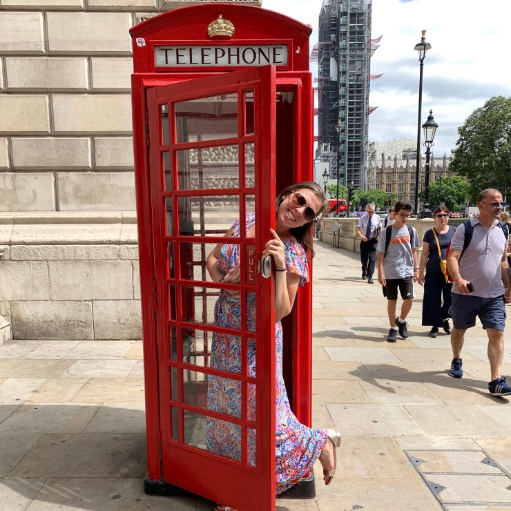 Posing in front of red telephone booth