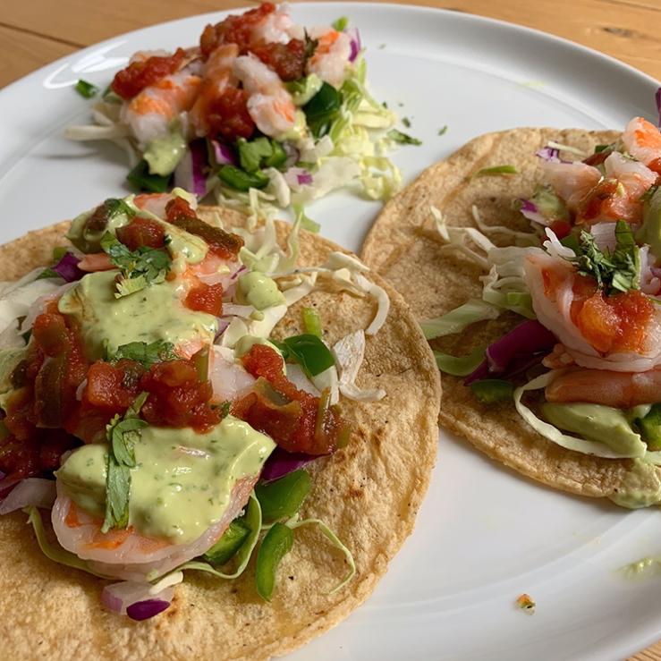 Shrimp tacos with avocado cilantro crema